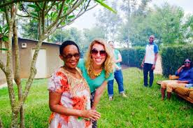 The Women's Bakery founder Markey Culver standing next to with an African woman in Africa